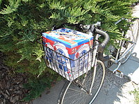 beer in bicycle basket