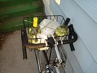 Wine and frozen veggies in basket